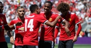 Manchester United celebrating after beating <a href='#myModal13' role='button' title='Click here for more info' data-toggle='modal'>Real Madrid</a>