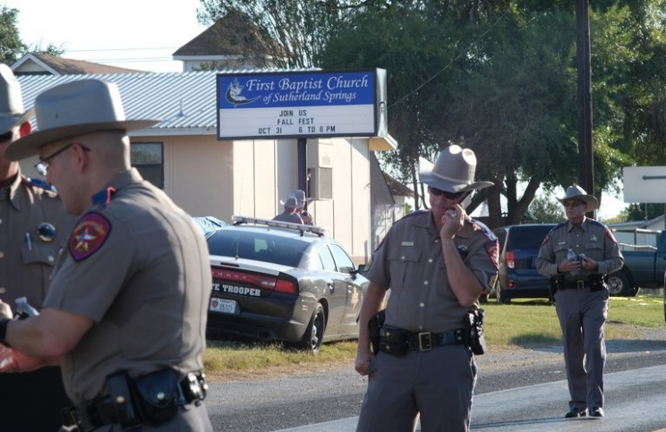 Texas Department of Public Safety troopers outside the First Baptist Church of Sutherland Springs, where at least 26 people were killed on Sunday.