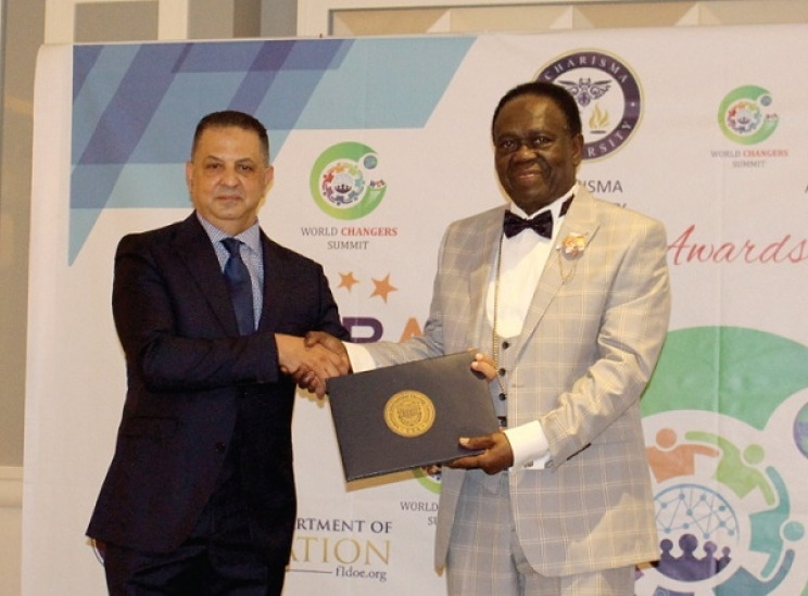 Archbishop Prof. Dr Asafo-Agyei Anane Frempong (right) receiving his award in Dubai