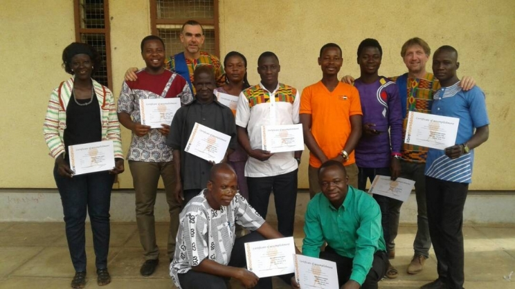 Participants in group picture with their certificates