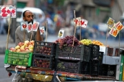 An Egyptian fruit seller is seen at a market in Cairo, Egypt June 18, 2017