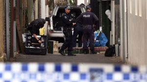 Police search for evidence at a home in inner Sydney