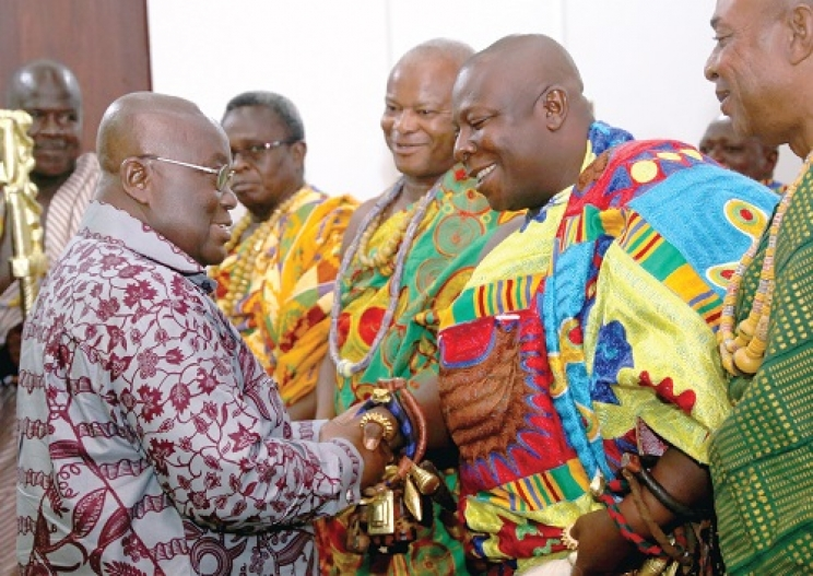 Akufo-Addo interacting with some Chiefs who paid a courtesy call on him at the Flagstaff House